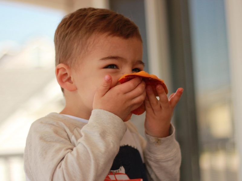 photo of Kimberly Spair's son eating a mango