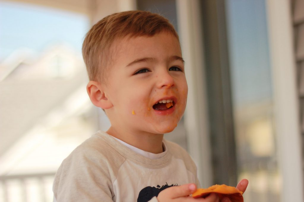 photo of Kimberly Spair's son eating mango and laughing