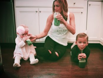 photo of Kimberly Spair and kids drinking green juice for boosting immunity