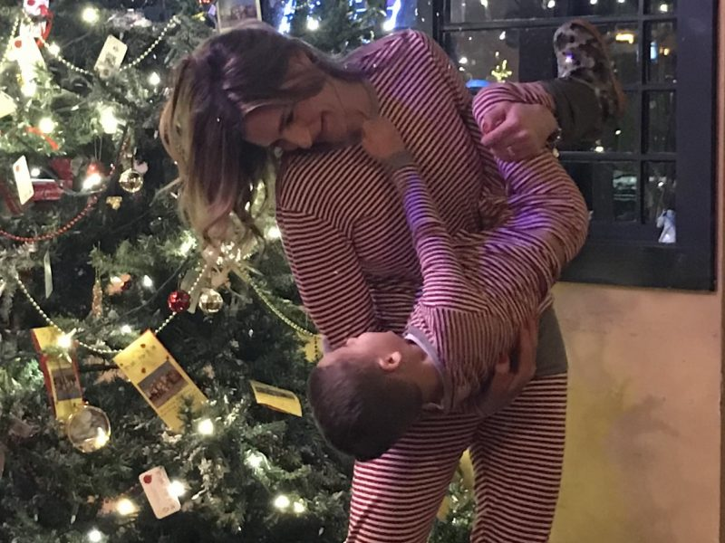 photo of Kimberly Spair and son playing in front of the Christmas tree