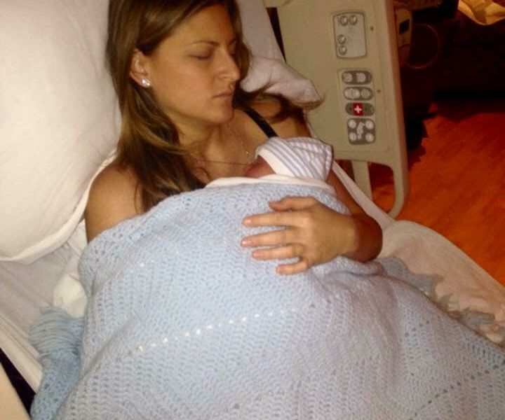 Kimberly after her first birth holding son