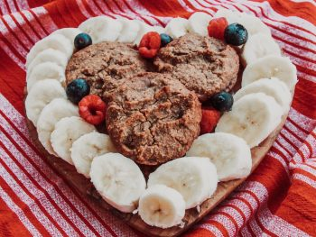 photo of banana muffins plated with bananas in heart shape