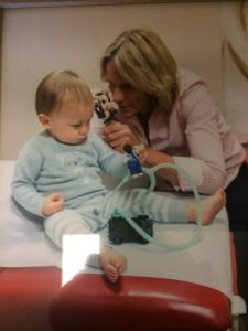 photo of Dr. Hendrieka Fitzpatrick examining a toddler