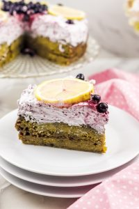 Slice of spiced lemon cake with wild blueberry frosting