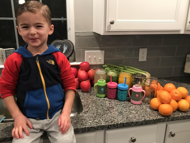 photo of Kimberly's son, Brycen, posing with plastic free food storage containers and cups