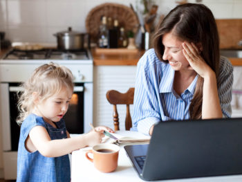 photo of a mom working from home with her young daughter