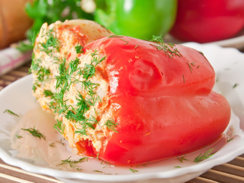 photo of stuffed peppers plated with fresh dill